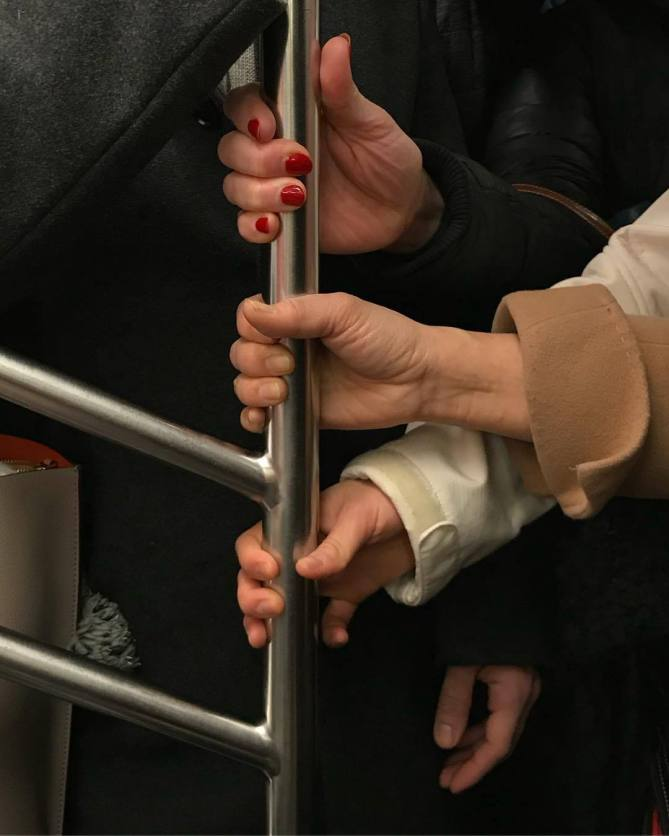 HANDS IN SUBWAY